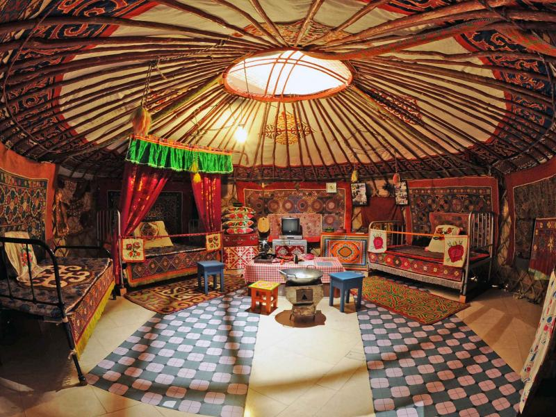 The yurt is a house used by farmer nomads in Mongolia and Afghanistan to graze their cattle during summer. The interior offers familiarity and cosiness.